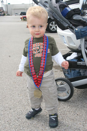 Griffin posing with the finishers medal.