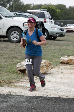 Ilse Wakley arriving at South D&D aid station in the 20km. Only 2.43 more miles! (Photo: Copyright Movin Pictures / movin-pictures.com)