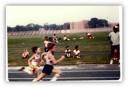 Me at 10. The UNM Track Days:  Me losing the first of many races as a kid. In the yellow shorts and awesome socks.
